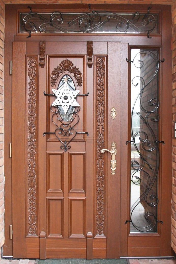 Drzwi zewnętrzne stylowe ekskluzywne z rzeźbą i metaloplastyką  LZ 529