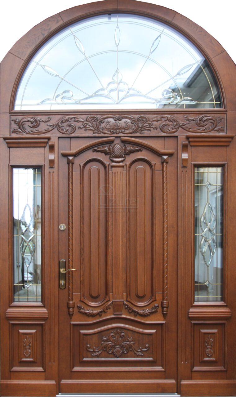 Drzwi zewnętrzne drewniane z łukiem Parkowa Snycerka LZ637
